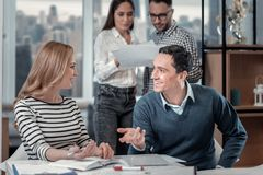 Cheerful woman talking with her co-worker royalty free stock photos