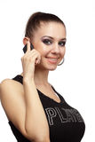 Cheerful woman talking on a phone Royalty Free Stock Images