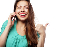 Cheerful woman talking on the phone isolated on a white backgrou Royalty Free Stock Photography