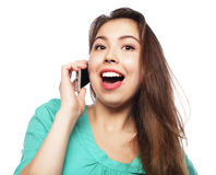 Cheerful woman talking on the phone isolated on a white backgrou Royalty Free Stock Image