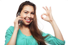 Cheerful woman talking on the phone isolated on a white backgrou Stock Photos