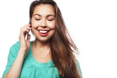 Cheerful woman talking on the phone isolated on a white backgrou Stock Photography