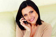 Cheerful woman talking on the phone Royalty Free Stock Image