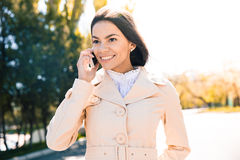 Cheerful woman talking on the phone Royalty Free Stock Photography