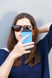Cheerful woman talking on the phone Stock Photos