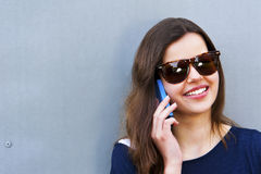 Cheerful woman talking on the phone in the street casual outfit Royalty Free Stock Image
