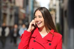 Cheerful woman talking on the phone in the street Stock Image