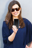 Cheerful woman talking photo on the phone in the street casual o Royalty Free Stock Photo
