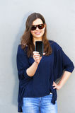 Cheerful woman talking photo on the phone in the street casual o Royalty Free Stock Images