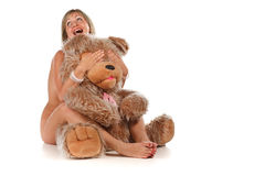 Cheerful woman with teddy bear Stock Photo
