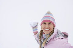 Cheerful Woman Throwing Snowball Royalty Free Stock Image
