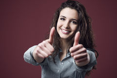 Cheerful woman thumbs up Stock Photo