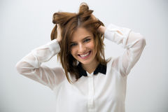 Cheerful woman touching her head Royalty Free Stock Photography