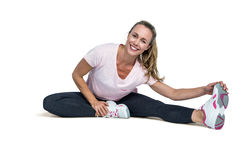 Cheerful woman touching toes while exercising Royalty Free Stock Image