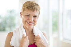 Cheerful Woman With Towel Around Neck Stock Photo