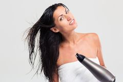 Cheerful woman in towel drying her hair Stock Photography