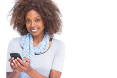 Cheerful woman typing a text message Stock Photo