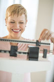 Cheerful Woman Using Balance Weight Scale Stock Image