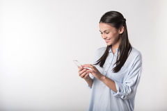 Cheerful woman using cell phone Royalty Free Stock Image
