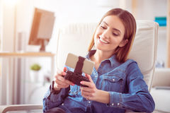 Cheerful woman using game console Royalty Free Stock Photos