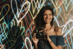Cheerful woman using an instant camera stock photos