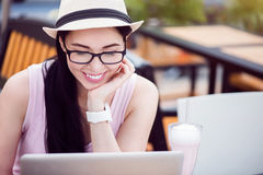 Cheerful woman using laptop Stock Photo