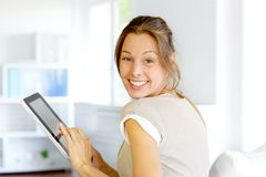 Cheerful woman using touchpad Royalty Free Stock Photography