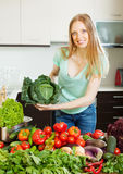 Cheerful  woman with  vegetables and greens. Cheerful beautiful woman with raw vegetables and greens Stock Images