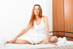 Cheerful  woman waking in her bed Royalty Free Stock Photos