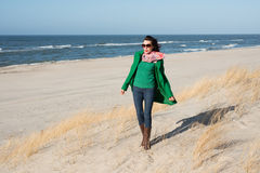 Cheerful woman walks on nature spring Royalty Free Stock Photos