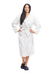 Cheerful woman in a white bathrobe Royalty Free Stock Images