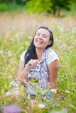 Cheerful woman wildflowers Royalty Free Stock Photo
