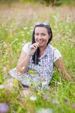 Cheerful woman wildflowers Royalty Free Stock Photography
