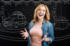 Cheerful woman winning the car. Cant believe. Overjoyed delighted woman expressing gladness after winning the car in a lottery stock images