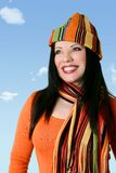 Cheerful woman in winter scarf and hat Stock Photos