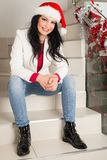 Cheerful woman wit Santa hat Stock Photography