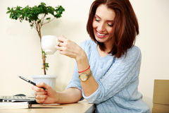 Cheerful woman working Stock Images