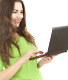 Cheerful woman working on laptop Stock Photos
