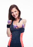 Cheerful woman working out with dumbbells Stock Image