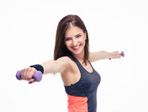 Cheerful woman working out with dumbbells Stock Photo