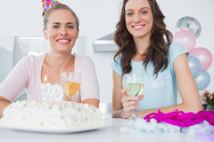 Cheerful women with birthday cake Stock Photo