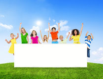 Cheerful Women and Children Raising Arms Royalty Free Stock Photos
