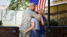 Excited family meeting serviceman at home stock photo