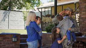 Excited family meeting serviceman at home royalty free stock photography