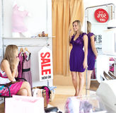 Cheerful women choosing clothes together Royalty Free Stock Image