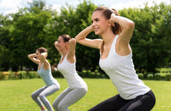 Cheerful women doing sport exercises. Follow healthy way of life. Cheerful smiling beautiful women expressing gladness while doing sport exercises royalty free stock photo