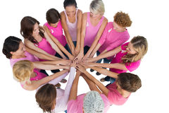 Cheerful women joined in a circle wearing pink for breast cancer Royalty Free Stock Image