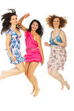Cheerful women jumping togheter. Cheerful three women jumping together isolated on white background Royalty Free Stock Photos