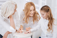 Cheerful women painting nails Stock Images
