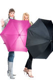 The cheerful women  with a pink and black umbrella Stock Images